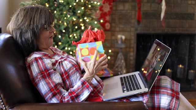 socially distanced christmas with grandma and granddaughter - christmas stock videos & royalty-free footage
