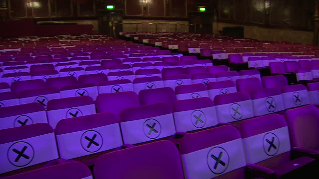 socially distanced seating inside london palladium theatre for pilot show, of live performance by singer beverley knight, to test new coronavirus... - 席点の映像素材/bロール