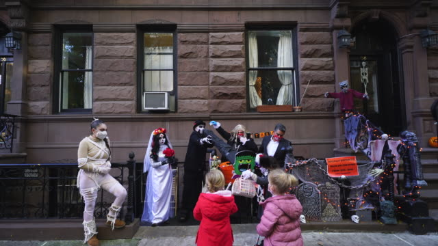 socially distanced trick-or-treating this year people created the special tube to keep social distance to give the candy to the children. - baby boys stock videos & royalty-free footage