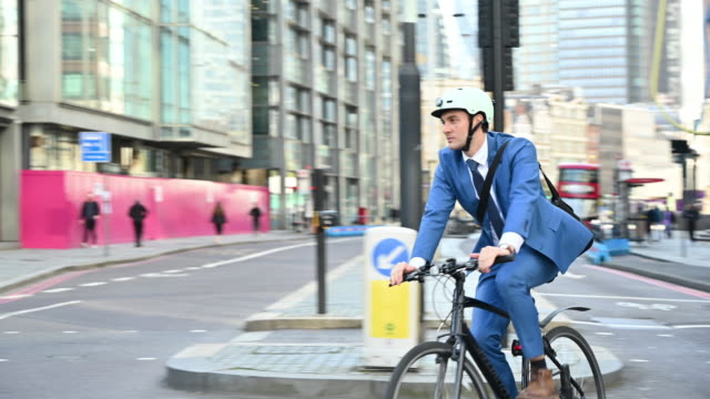 socially responsible british businessman cycling to work - businesswear stock videos & royalty-free footage