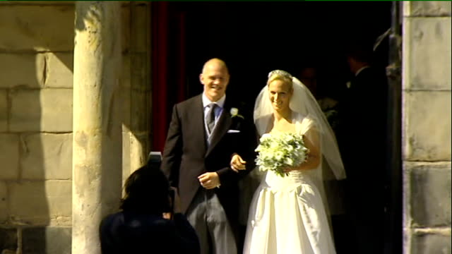 decline in 'aspirational marriages' for women 3072011 SCOTLAND Edinburgh Canongate Kirk EXT Zara Phillips and Mike Tindall standing on steps of...