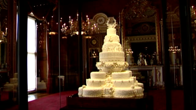 decline in 'aspirational marriages' for women LIB Buckingham Palace INT Duke and Duchess of Cambridge wedding cake on display in glass case
