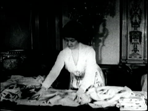 society women help with war effort by sewing clothing ask public to contribute gloves hosiery and discarded articles in order to make clothing for... - 1918 stock videos and b-roll footage