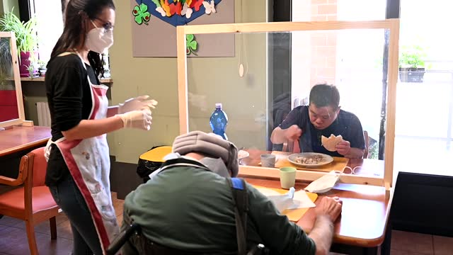 socio-health worker of the social cooperative paradigm helps eating people with down syndrome inside at the paradigma social cooperative on april 20... - intellectual disability stock videos & royalty-free footage