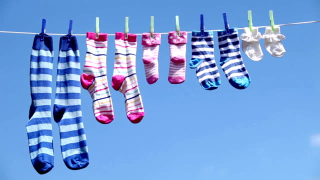 sock family comp - washing line stock videos & royalty-free footage
