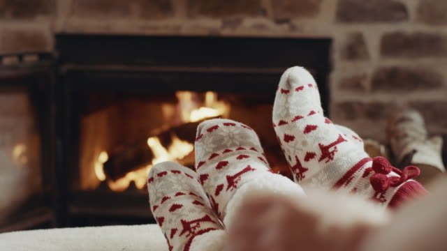 socks in front of the fireplace - sock stock videos & royalty-free footage
