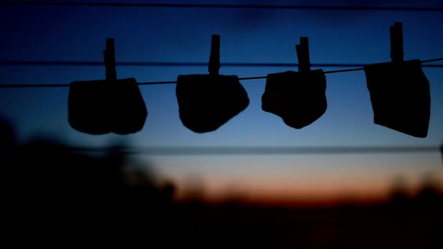 socks on string, balcony view - clothes peg stock videos & royalty-free footage