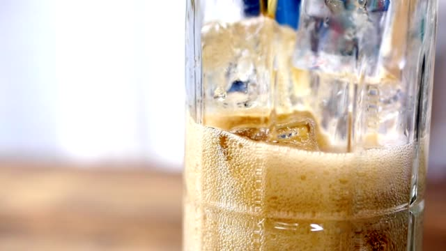 soda being poured into clear glass with ice. - transparent stock videos & royalty-free footage