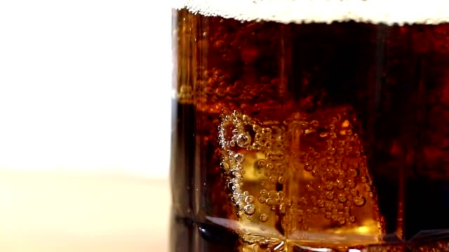 soda being poured into clear glass with ice. - filling stock videos and b-roll footage