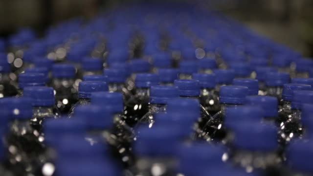 cu soda bottles on manufacturing line / soda bottling plant. - bottling plant stock videos & royalty-free footage