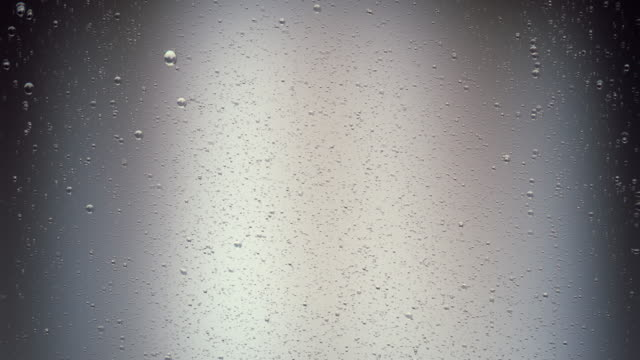 soda bubbles on grey background - carbonated drink stock videos & royalty-free footage