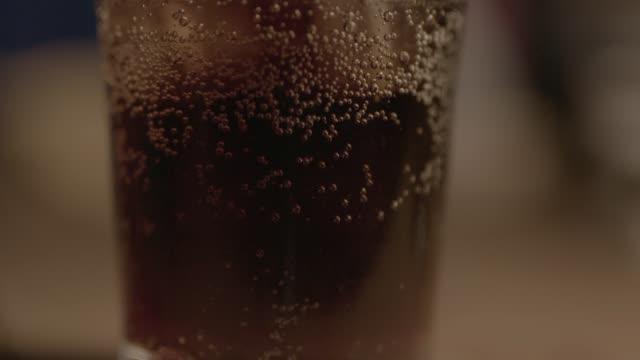 Soda bubbling in slow motion