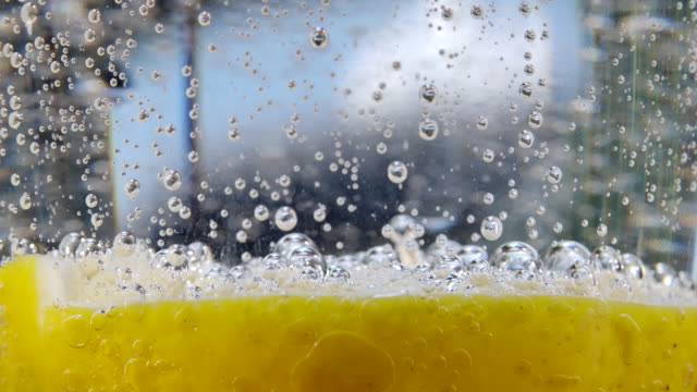 soda lamon water in clear glass - carbonated stock videos & royalty-free footage