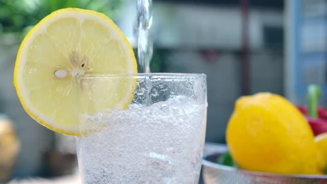 soda lamon water in clear glass - slice stock videos & royalty-free footage