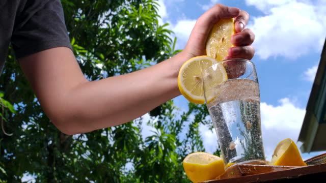 soda lamon water in clear glass - fizzy lemonade stock videos & royalty-free footage