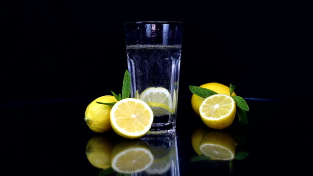 soda water with lemon slice - stock video - mint leaf culinary stock videos and b-roll footage