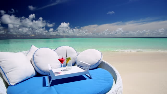 sofa and cocktails on a tropical beach, maldives, indian ocean  - tropical drink stock videos and b-roll footage