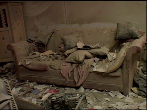 sofa covered with dust and debris in ruins of liberty street apartment; near ground zero, nyc after september 11 terrorist attacks. - september 11 2001 attacks stock-videos und b-roll-filmmaterial