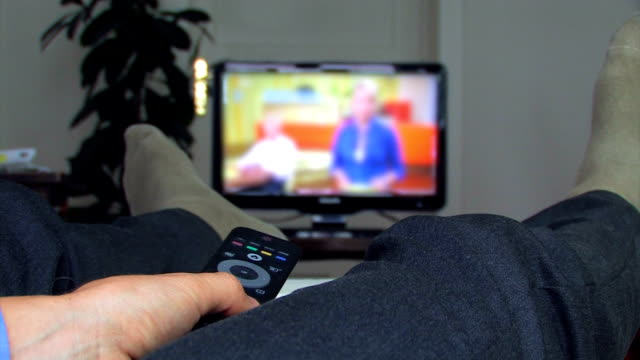 sofa surfing with tv - changing channels stock videos & royalty-free footage