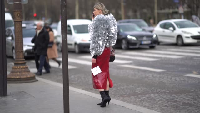 Sofie Valkiers wears a silver oversized coat a red leather skirt a Chanel bag outside Chanel during Paris Fashion Week Womenswear Fall/Winter...