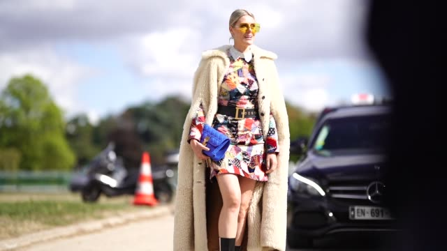 sofie valkiers wears a white fluffy coat, a multicolor dress, a blue bag from dior, outside dior, during paris fashion week womenswear spring/summer... - fluffy stock videos & royalty-free footage