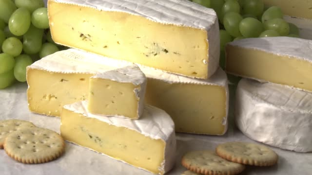 soft cheese, crackers and grapes - cheese stock videos & royalty-free footage