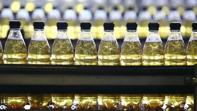 soft drink bottling line closeup - polyethylene terephthalate stock videos and b-roll footage