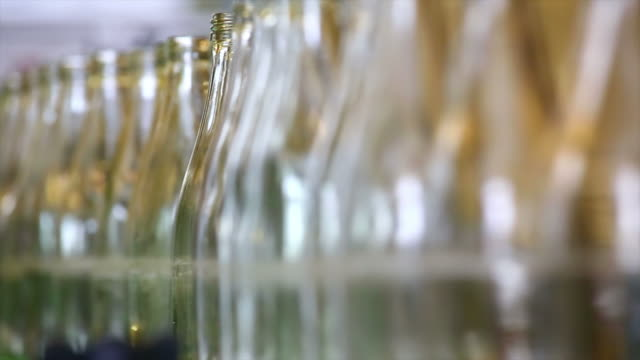 soft drink bottling line close-up - filling stock videos & royalty-free footage