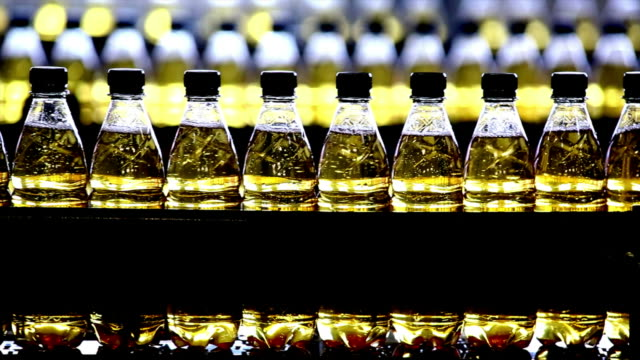 soft drink bottling line close-up - polyethylene terephthalate stock videos and b-roll footage