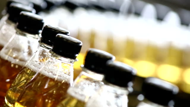 soft drink bottling line close-up - bottling plant stock videos and b-roll footage