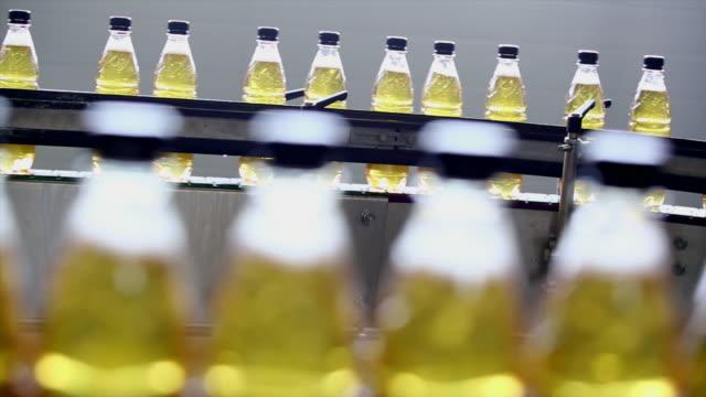 soft drink bottling line - polyethylene terephthalate stock videos and b-roll footage