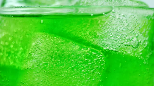 soft drink green apple juice close-up white background 4k resolution - carbonated drink stock videos & royalty-free footage