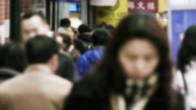soft focus of a crowded sidewalk in chinatown on a winter day. - soft focus stock videos & royalty-free footage