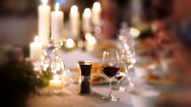 soft focus of table set for for wedding reception or event party with cutlery and candles. - wedding reception stock videos & royalty-free footage