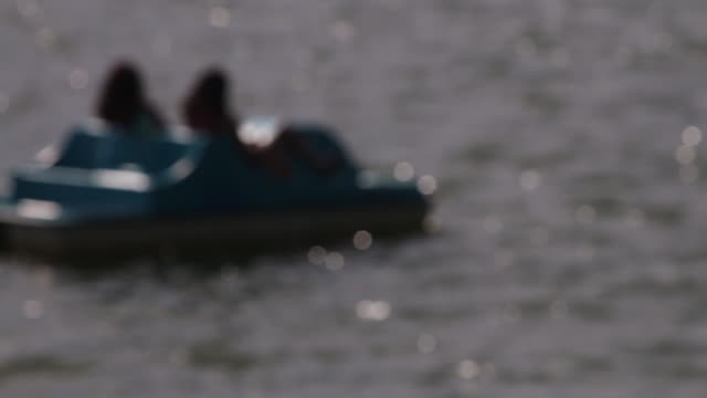 soft focus, paddle boat on a lake - soft focus stock videos & royalty-free footage