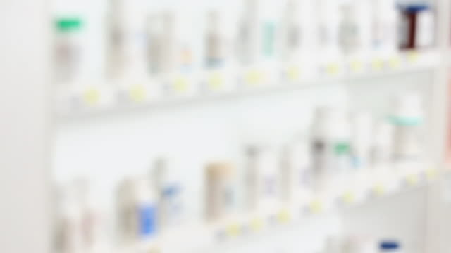 WS TU Soft Focus Pharmacy Shelves Full of Medication Bottles / Richmond, Virginia, USA