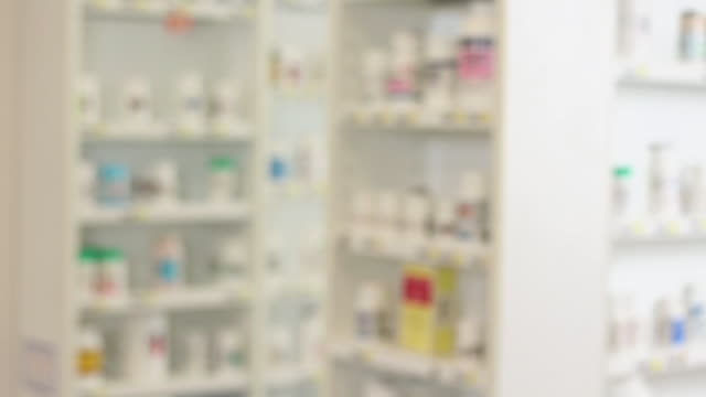 WS PAN Soft Focus Pharmacy Shelves Full of Medication Bottles / Richmond, Virginia, USA