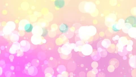vídeos y material grabado en eventos de stock de mezcla suave de color bokeh sobre fondo rosa - purpurina