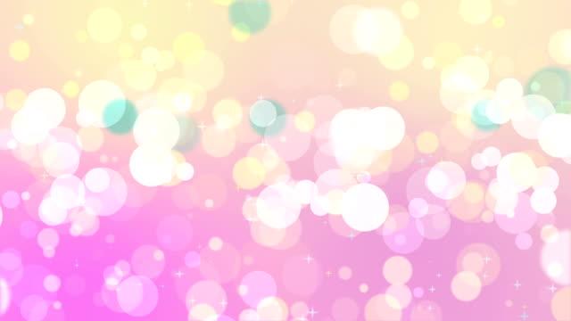vídeos de stock e filmes b-roll de soft mix colored bokeh on pink background - pink colour