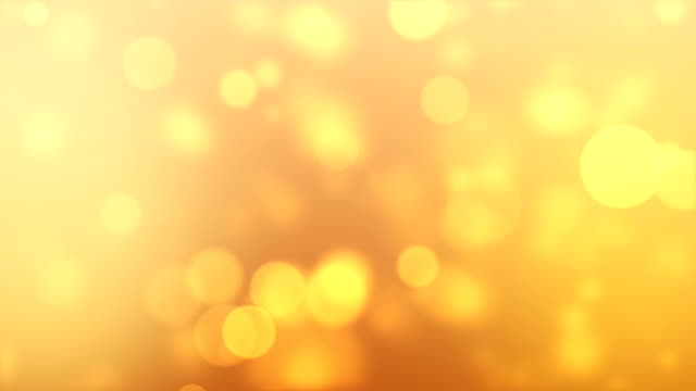 soft particle gold background 4k (loopable) - gold colored stock videos & royalty-free footage