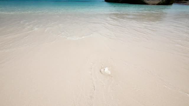 Soft sea wave on a white sand beach