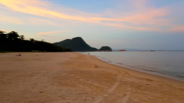 soft wave of blue ocean on sandy beach with sunset orange sky - grace bay stock videos and b-roll footage