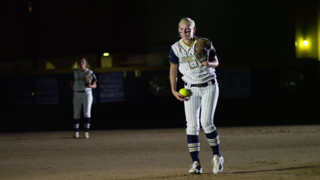 MS Softball game Player throwing ball on ground / Riverside, California, United States
