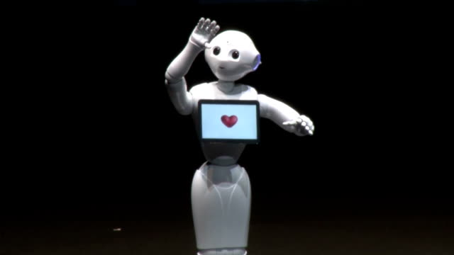 """softbank corp.'s humanoid robot """"pepper,"""" claimed to be the world's first personal robot able to read emotions, will go on sale to the general public... - cyborg stock videos & royalty-free footage"""