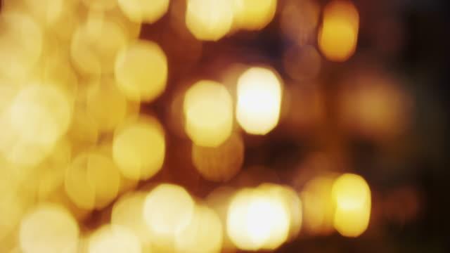 soft-focus light bulbs of a marquee sign flash in brilliant orange and gold light. - festzelt stock-videos und b-roll-filmmaterial