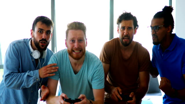 software developers playing video games on a break. - handsome people stock videos & royalty-free footage