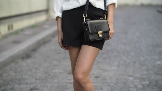 vídeos y material grabado en eventos de stock de sofya benzakour , is wearing a new look white shirt, an asos black short, asos shoes, and a monki bag, during a street style session, on july 9, 2016... - camisa blanca
