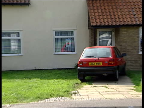 day's events itn lib cambridgeshire soham missing poster for murdered girls holly wells and jessica chapman in window of ian huntley's home pull... - missing poster stock videos & royalty-free footage