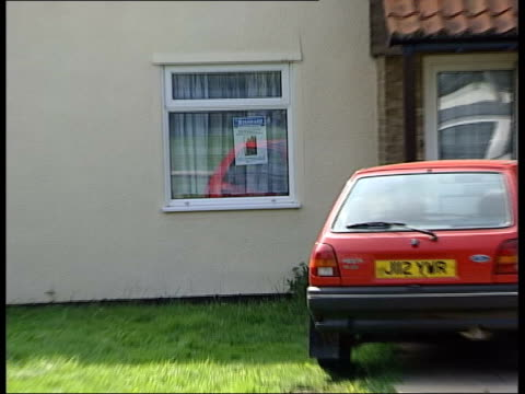 day's events lib cambridgeshire soham missing poster for murdered girls holly wells and jessica chapman in window of ian huntley's home pull... - missing poster stock videos & royalty-free footage