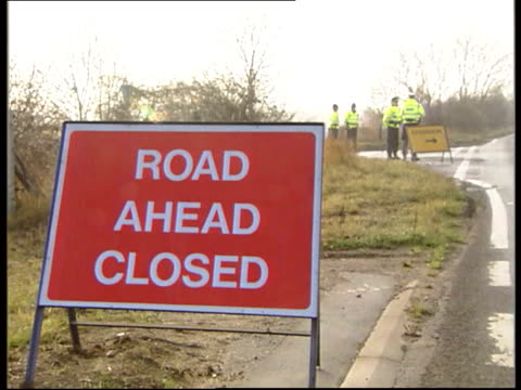 jurors visit site where bodies found; gv keeper's cottage where huntley's father lived sign 'road closed ahead' mss police officers manning exclusion... - road closed sign stock videos & royalty-free footage